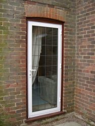 White aluminium entrance door with leaded glass