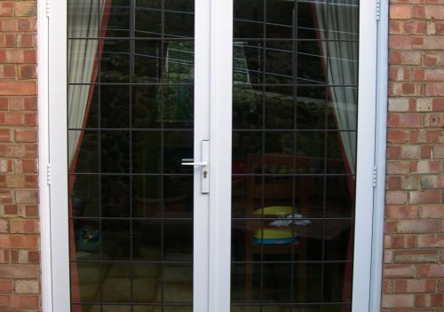 White aluminium french door with leaded glass