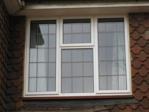 White aluminium leaded casement window