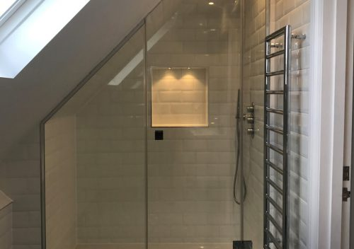 Angled glass shower door