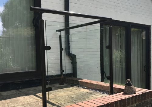Glass balustrade with a black railing