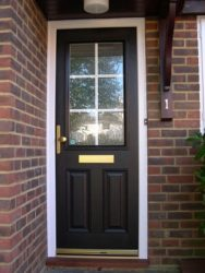 Black and white composite entrance door