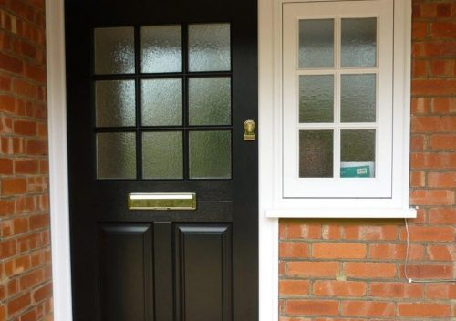 Black timber entrance door