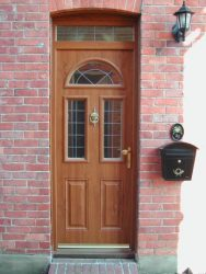 Cherry Oak effect composite entrance door