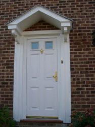 Cream composite entrance door