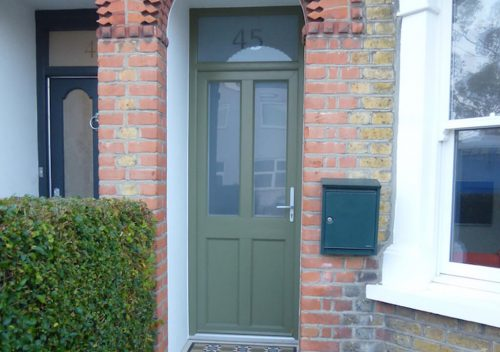 Dark green timber alternative entrance door