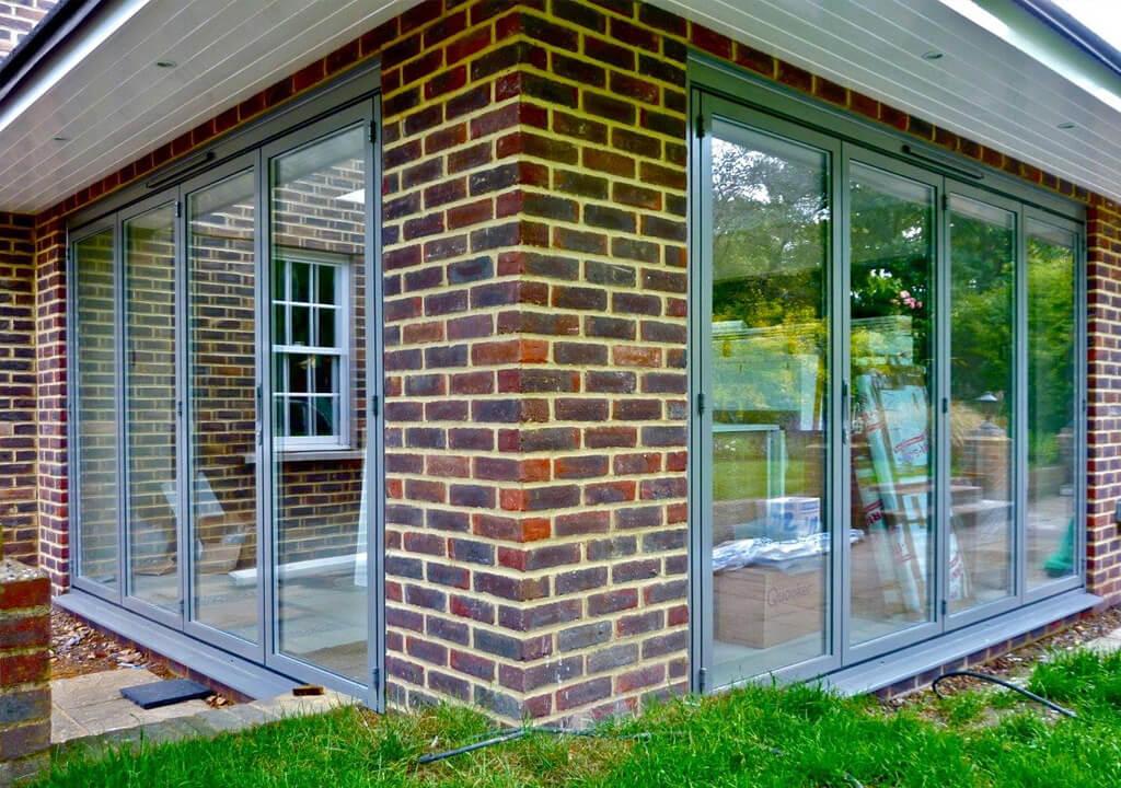... Dual grey Sunflex aluminium bifold door ... & Sunflex Bifold - P \u0026 P Glass
