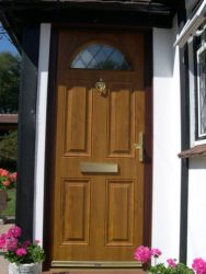 Dual oak effect composite entrance door