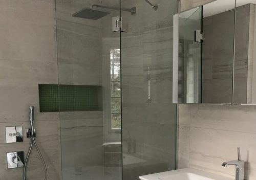 Folding glass shower door