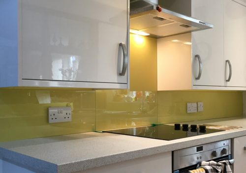 Green kitchen glass splash back