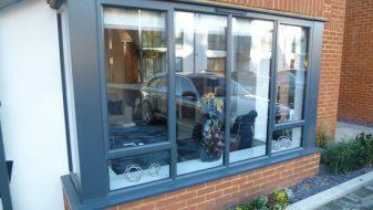 Grey slimline aluminium bay window