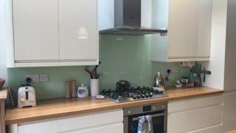 Light green kitchen glass splash back