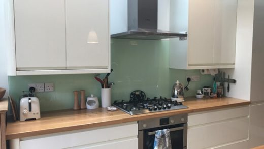 Light green kitchen glass splash back
