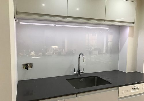 Light grey sink glass splash back