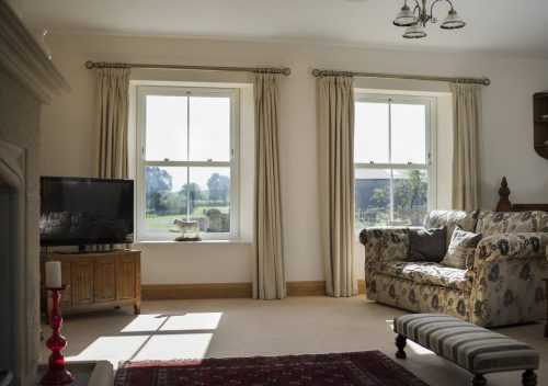 Living room uPVC sliding sash window