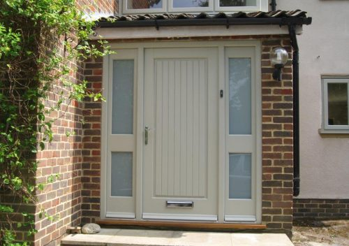 Modern timber entrance door with side panels