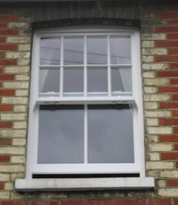 An open white timber sliding sash window