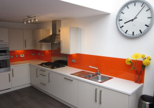 Orange kitchen glass splash back