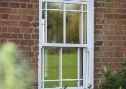 White uPVC sliding sash window close up