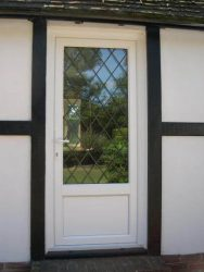 White PVC door with cross style leading