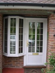 White PVC entrance door and bay window