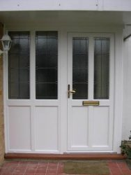 White uPVC entrance door with a side panel