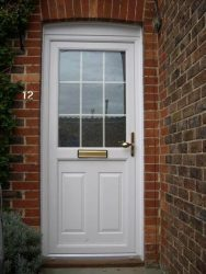 uPVC entrance door with astragal bars