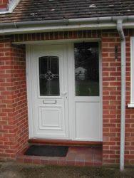 White uPVC entrance door with custom glass design