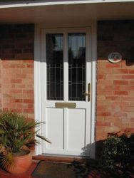 White PVC entrance door with leaded glass