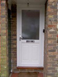 White uPVC entrance door with silver door