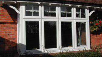 White sculptured casement windows