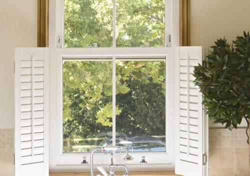 uPVC sliding sash window with shutters