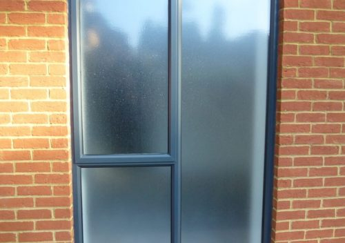 Slimline aluminium window with frosted glass