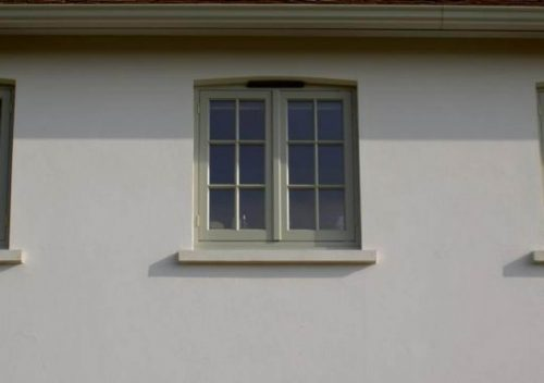 Small green timber flush sash window