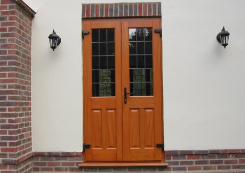 Stained timber french door