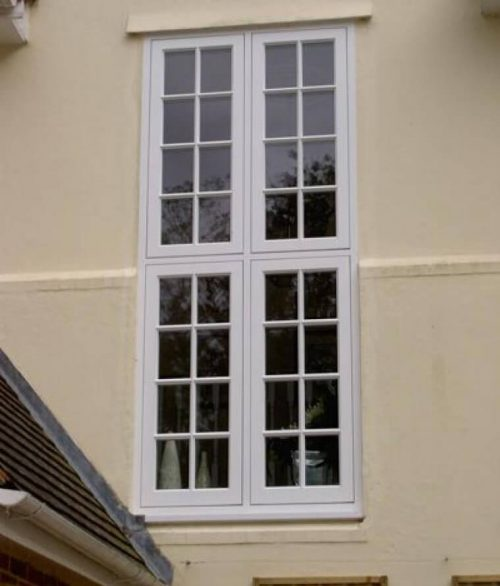 Tall white timber flush sash window