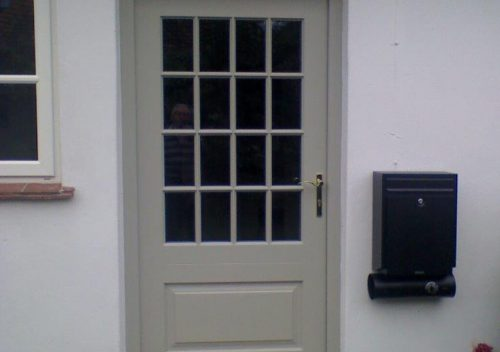 timber entrance door with astragal bars