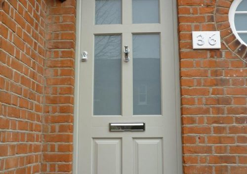 Grey timber entrance door