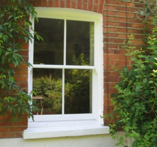 White timber sliding sash window