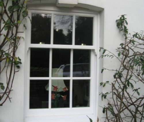 White timber vertical sliding window