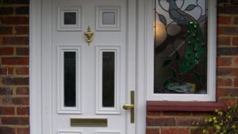 White uPVC entrance door with a side window