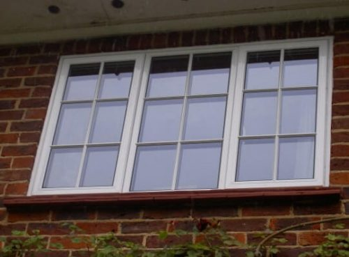 White aluminium casement window with astragal bars
