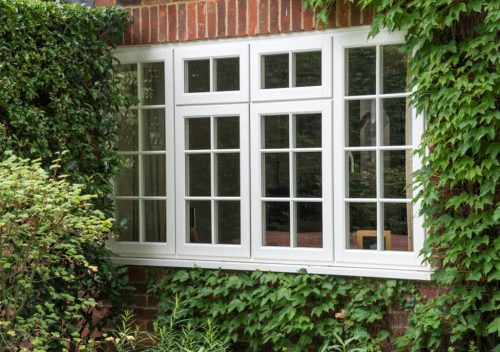 White casement timber effect window