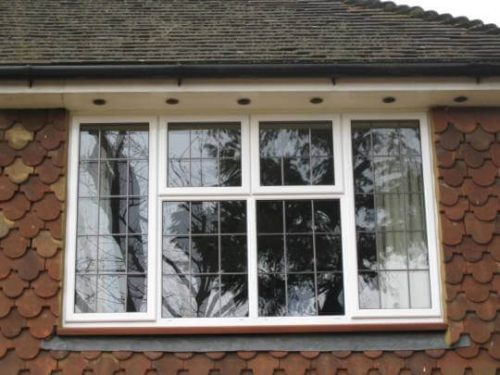 White leaded aluminium casement window