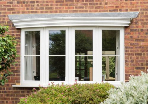 White uPVC timber effect bow window
