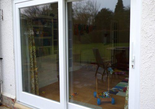 White timber patio door installation