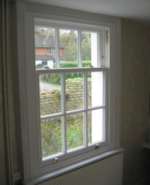 White vertical sliding timber window interior view