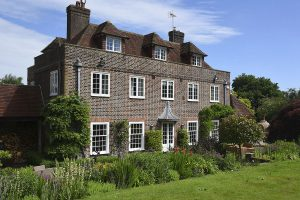 White uPVC casement and sliding window manor residence
