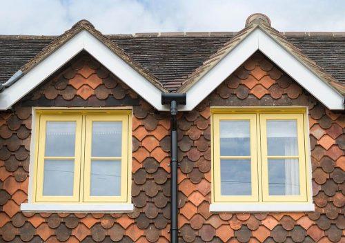 Evolution yellow casement windows