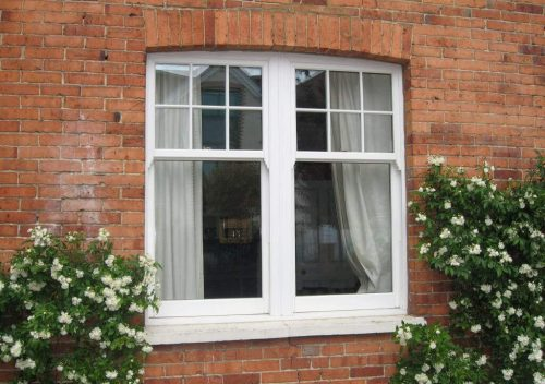Dual White uPVC Vertical Sliders